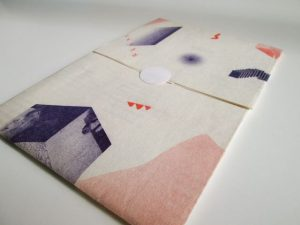 The third issue of Re- came packaged in a beautifully folded and designed sleeve-envelope.
