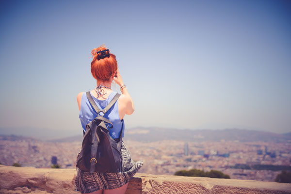 city-woman-view-blue-sky